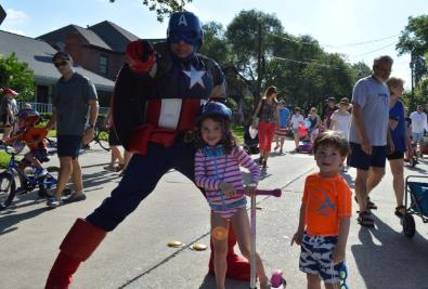 Captain America superhero costumed character at the west university 4th of July parade.