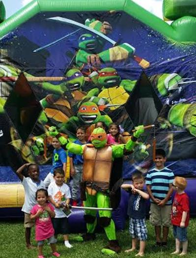 Michaelangelo ninja turtle super hero costumed character party in Katy, texas.