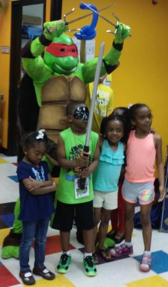 Raphael ninja turtle rental superhero costume for birthday party at pump it up in Houston, Texas.