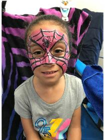 Full face painting clown in Houston for your child's birthday party for a painting like Spidergirl.