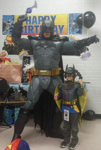 Batman's suit is solid with a fully functioning utility belt for super hero birthday costumed character parties in Houston, Texas.