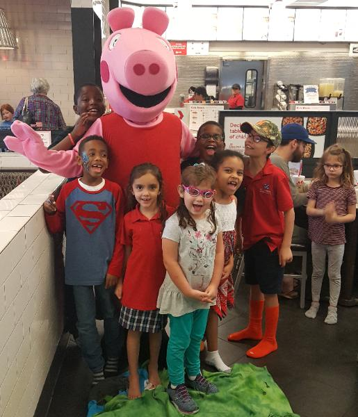 Chick-fila fun with this group of kids and this Brittish pig friend.