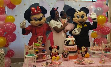 Mice just want to have fun in Pearland with mascot costumed characters for cake and pictures.