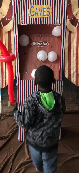Carnival games are always fun at Houston birthday parties, a must try is the balloon pop game.