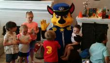 Chase from paw patrol mascot costumed character for a birthday party  in Pearland , Texas.