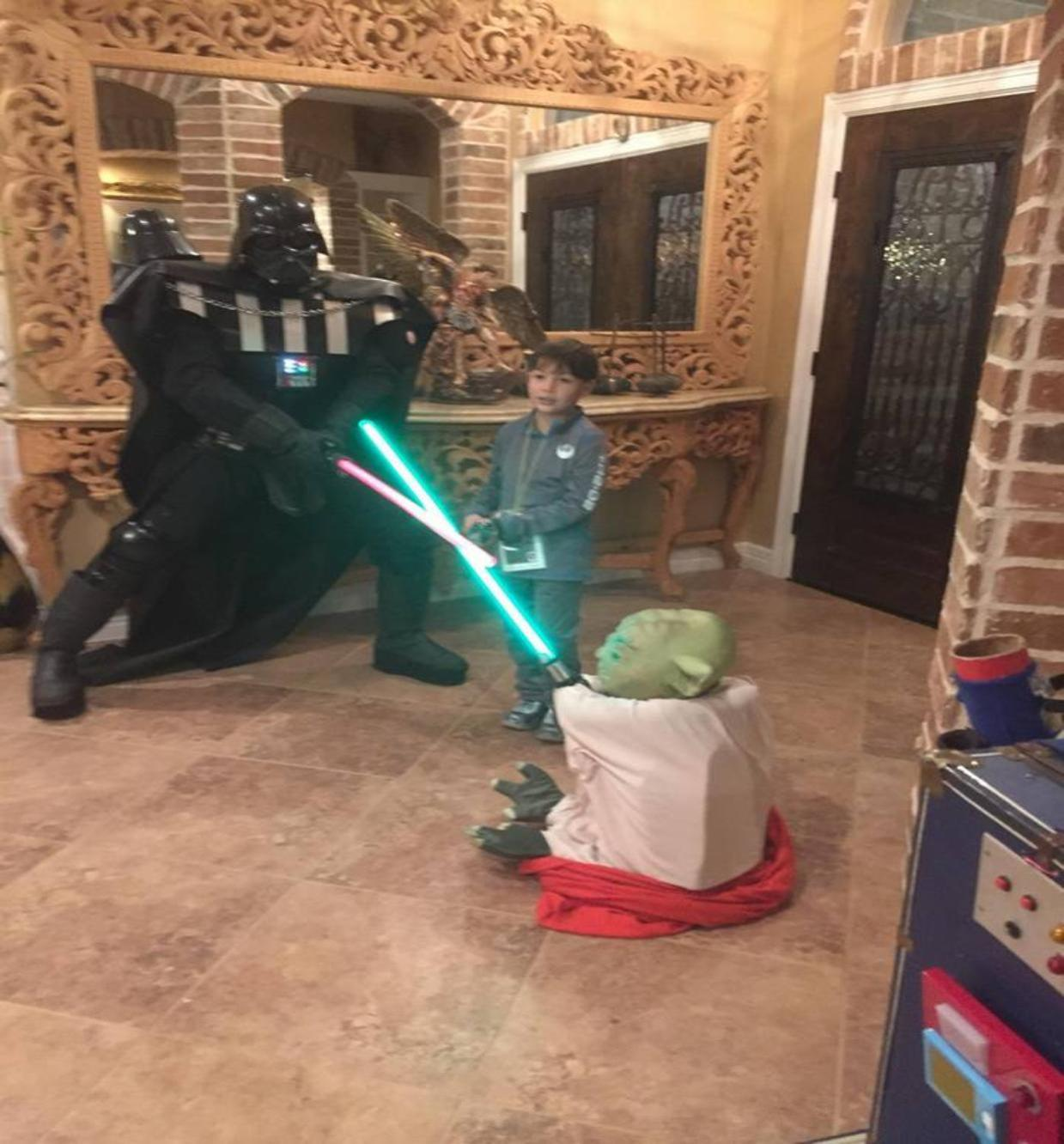 Darth vader rental battles the yoda prop for a super hero birthday party in Houston, Texas.