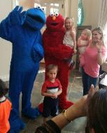 Cookie monster and elmo mascots in midtown houston, texas for a rental birthday party.