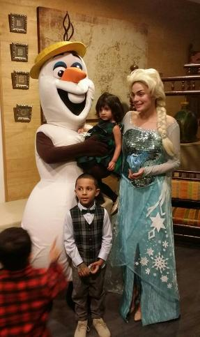 Costumed characters Elsa and Olaf from Frozen at a birthday party in Houston, Texas.