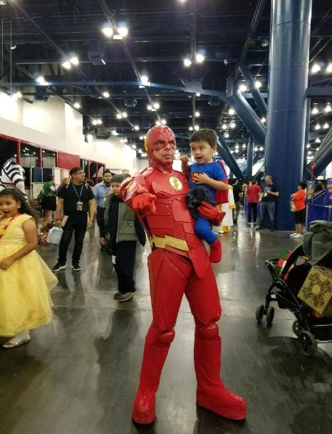 The Flash is joined by a super hero party fan at comicpalooza in Houston, Texas.