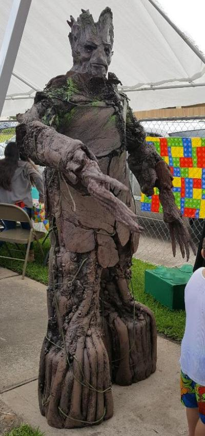 Groot superhero if 7 feet tall for birthday party in spring, texas.