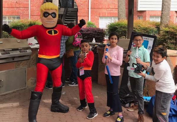 Houston mascot superheroes at your Houston birthday party can omnly make it better with cool photo props.