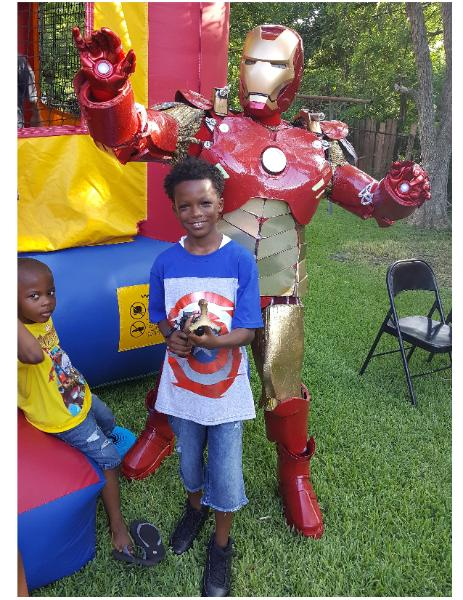 rent this metal super hero for a memorable kids birthday celebration in Houston, comes with awesome props and games.