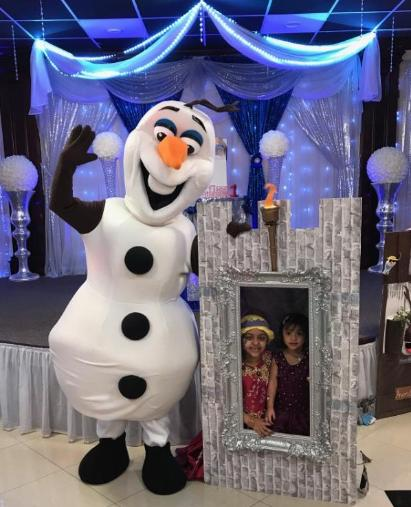 Invite this snowman mascot party character for your special birthday event in Houston with this awesome castle wall photo prop