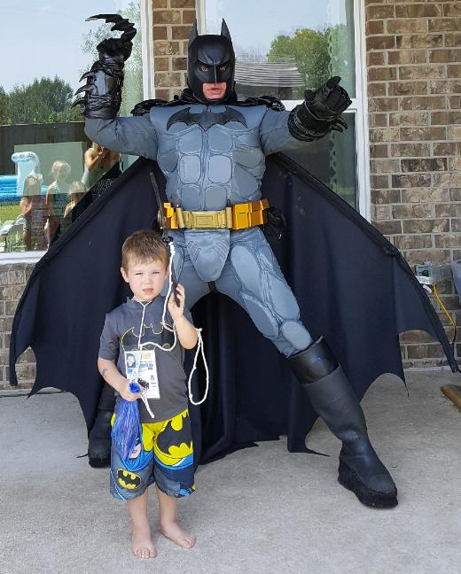 Rental available for a Batman superhero mascot costumed character for birthday parties with awesome photo props in Houston, Texas.
