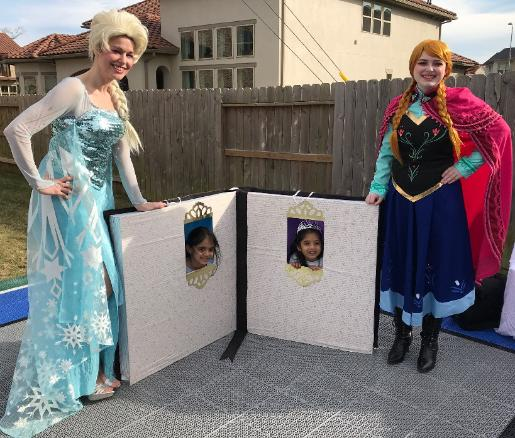 Hire the snow sisters princess party characters for your Houston birthday party with a nice storybook photo prop