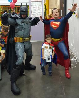 Hire a superhero character for a birthday party in Houston like this one with 2 costumed super heroes at Wonder Wild on Shepard.