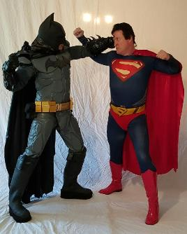 Superman and Batman battle at your superhero party for your child's birthday party in Houston, Texas.